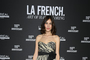 "Alexa Chung poses at a photocall during the ""La French-Art Of Coloring"" - 110th Anniversary of L'Oreal Professional At Carrousel Du Louvre on March 24, 2019 in Paris, France."