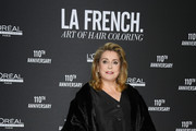 """Catherine Deneuve poses at a photocall during the """"La French-Art Of Coloring"""" - 110th Anniversary of L'Oreal Professional At Carrousel Du Louvre on March 24, 2019 in Paris, France."""