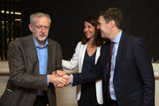 Labour leadership candidate Jeremy Corbyn (L) is greeted by fellow candidates Andy Burnham (R) and Liz Kendall (C) ahead of a radio hustings on August 25, 2015 in Stevenage, England. Candidates are continuing to campaign for Labour party leadership with polls placing left-winger Jeremy Corbyn in the lead. Voting is due to begin on the 14th of August with the result being announced on the 12th of September.