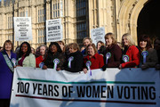 Female members of the Shadow Cabinet and Labour politicians stand on college green with a '100 Years of Women Voting' banner on February 6, 2018 in London, England. Today marks the 100th anniversary of the Representation of People Act 1918, which gave women the vote.