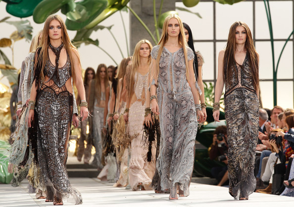 Laetitia Casta Models Natalia Vodianova and Laetitia Casta walk down the runway during the Roberto Cavalli Milan Fashion Week Womenswear S/S 2011 show on on September 27, 2010 in Milan, Italy.