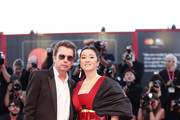 """Jean Michel Jarre and Gong Li walks the red carpet ahead of the """"Lan Xin Da Ju Yuan"""" (Saturday Fiction) screening during the 76th Venice Film Festival at Sala Grande on September 04, 2019 in Venice, Italy."""