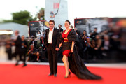 """This image has been taken with lens baby) Gong Li walks the red carpet ahead of the """"Lan Xin Da Ju Yuan"""" (Saturday Fiction) screening during the 76th Venice Film Festival at Sala Grande on September 04, 2019 in Venice, Italy."""