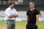 Andrew Flintoff speaks with Steve Harmison in the interval during the Royal London One Day Cup match between Lancashire Lightning and Yorkshire Vikings at Old Trafford on July 26, 2014 in Manchester, England.