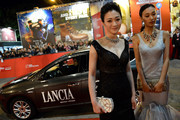 (L-R) Li Xiaoran and Qin Shupei attend the 'Bullet To The Head' premiere during the 7th Rome Film Festival on November 14, 2012 in Rome, Italy.