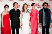"""(L-R) Vanesa Glodjo, Goran Kostic, Angelina Jolie and Gabriel Yared attend """"In the Land Of Blood And Honey"""" Pairs premiere on February 16, 2012 in Paris, France."""