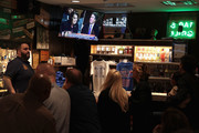 Patrons watch as the television at the Billy Goat Tavern plays live the Senate Judiciary Committee hearing on Capitol Hill where professor Christine Blasey Ford and Supreme Court nominee Brett Kavanaugh were testifying on September 27, 2018 in Chicago, Illinois. Ford has accused Kavanaugh of pinning her down and sexually assaulting her when they were both teens.