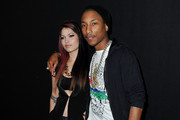 Maxine Ashley and Pharrell Williams attend the Lanvin Ready-To-Wear Fall/Winter 2012 show as part of Paris Fashion Week at Halle Freyssinet on March 2, 2012 in Paris, France.