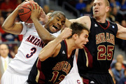 (L-R) Kevin Parrom #3 of the Arizona Wildcats and Michael Santos #13 and John McArthur #25 of the Santa Clara Broncos fight for a rebound during the third round of the Las Vegas Invitational at The Orleans Arena November 26, 2010 in Las Vegas, Nevada.