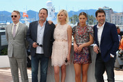 """(L-R) Jared Harris, Jean Reno, Charlize Theron, Adele Exarchopoulos and Javier Bardem attend """"The Last Face"""" Photocall during the 69th annual Cannes Film Festival at the Palais des Festivals on May 20, 2016 in Cannes, France."""