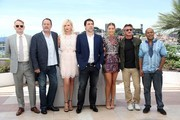 """(FromL) British actor Jared Harris, French actor Jean Reno, South African-US actress Charlize Theron, Spanish actor Javier Bardem, French actress Adele Exarchopoulos, US actor and director Sean Penn and US actor Zubin Cooper pose on May 20, 2016 during a photocall for the film """"The Last Face"""" at the 69th Cannes Film Festival in Cannes, southern France.  / AFP / Valery HACHE"""
