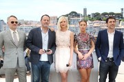 """(FromL) British actor Jared Harris, French actor Jean Reno, South African-US actress Charlize Theron, French actress Adele Exarchopoulos and Spanish actor Javier Bardem pose on May 20, 2016 during a photocall for the film """"The Last Face"""" at the 69th Cannes Film Festival in Cannes, southern France.  / AFP / Valery HACHE"""