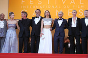 """Actor Zubin Cooper, Dylan Penn, director Sean Penn, actor Jean Reno, actress Adele Exarchopoulos, actor Hopper Penn, actress Charlize Theron and actor Jared Harris attend """"The Last Face"""" Premiere during the 69th annual Cannes Film Festival at the Palais des Festivals on May 20, 2016 in Cannes, France."""