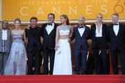 """(FromL) US actor Zubin Cooper, Sean Penn's daughter Dylan Frances Penn, US actor and director Sean Penn, French actor Jean Reno, French actress Adele Exarchopoulos, Sean Penn's son Hopper Jack Penn, South African-US actress Charlize Theron and British actor Jared Harris as they arrive on May 20, 2016 for the screening of the film """"The Last Face"""" at the 69th Cannes Film Festival in Cannes, southern France.  / AFP / Valery HACHE"""