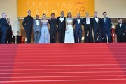 """(From 2ndL) US producer Matt Palmieri, US actor Zubin Cooper, US actress Dylan Penn, US actor and director Sean Penn, French actor Jean Reno, French actress Adele Exarchopoulos, US actor Hopper Penn, South African-US actress Charlize Theron, British actor Jared Harris and Spanish actor Javier Bardem pose with the General Delegate of the Cannes Film Festival Thierry Fremaux as they arrive on May 20, 2016 for the screening of the film """"The Last Face"""" at the 69th Cannes Film Festival in Cannes, southern France.  / AFP / LOIC VENANCE"""