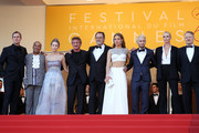 """Producer Matt Palmieri, actor Zubin Cooper, Dylan Peann, director Sean Penn, actor Jean Reno, actress Adele Exarchopoulos, actor Hopper Penn, actress Charlize Theron and actor Jared Harris attend """"The Last Face"""" Premiere during the 69th annual Cannes Film Festival at the Palais des Festivals on May 20, 2016 in Cannes, France."""