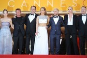 """US actor and director Sean Penn (2ndL), his daughter Dylan Frances Penn and (FromL) French actor Jean Reno, French actress Adele Exarchopoulos, Sean Penn's son Hopper Jack Penn, South African-US actress Charlize Theron and British actor Jared Harris pose as they arrive on May 20, 2016 for the screening of the film """"The Last Face"""" at the 69th Cannes Film Festival in Cannes, southern France.  / AFP / Valery HACHE"""