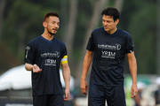 Hidetoshi Nakata and Jari Litmanen in discussion during the Laureus All Stars Unity Cup ahead of the 2014 Laureus World Sports Awards at Royal Selangor Club on March 25, 2014 in Kuala Lumpur, Malaysia.