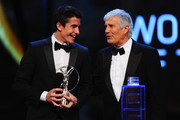Motor cyclist Marc Marquez accepts his Laureus World Breakthrough of the Year award from Laureus Academy member Giacomo Agostini during the 2014 Laureus World Sports Award show at the Istana Budaya Theatre on March 26, 2014 in Kuala Lumpur, Malaysia.