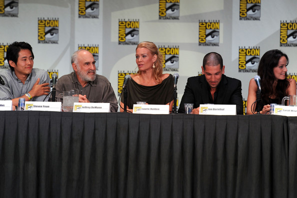 "Laurie Holden (L-R) Actors Steven Yeun, Jeffrey DeMunn, Laurie Holden, Jon Bernthal and Sarah Wayne Callies speak at AMC's ""The Walking Dead"" Panel during Comic-Con 2011 on July 22, 2011 in San Diego, California."