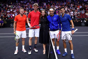 Team World Jack Sock of the United States, Team World Kevin Anderson of South Africa, Broadcaster Savannah Guthrie, Team Europe Roger Federer of Switzerland and Team Europe Novak Djokovic of Serbia pose prior to their Men's Doubles match on day one of the 2018 Laver Cup at the United Center on September 21, 2018 in Chicago, Illinois.