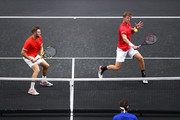 Team World Jack Sock of the United States and Team World Kevin Anderson of South Africa return a shot against Team Europe Novak Djokovic of Serbia and Team Europe Roger Federer of Switzerland during their Men's Doubles match on day one of the 2018 Laver Cup at the United Center on September 21, 2018 in Chicago, Illinois.