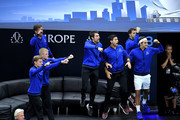 Team Europe Grigor Dimitrov of of Bulgaria, Team Europe Novak Djokovic of Serbia and Team Europe Roger Federer of Switzerland react during the Men's Singles match between Team Europe Alexander Zverev of Germany and Team World John Isner of the United States on day two of the 2018 Laver Cup at the United Center on September 22, 2018 in Chicago, Illinois.