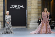 """Helen Mirren and Doutzen Kroes walk the runway during the """"Le Defile L'Oreal Paris""""  Show as part of Paris Fashion Week on September 28, 2019 in Paris, France."""