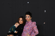 """Eva Longoria with her son Santiago and Aishwarya Rai pose on the runway during the """"Le Defile L'Oreal Paris""""  Show as part of Paris Fashion Week on September 28, 2019 in Paris, France."""