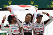 The Toyota Gazoo Racing TS050 Hybrid team of (L-R) Fernando Alonso, Kazuki Nakajima and Sebastien Buemi celebrate after Toyota win for the first time at the Le Mans 24 Hour race at the Circuit de la Sarthe on June 17, 2018 in Le Mans, France.