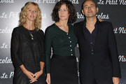 "Actresses Sandrine Kiberlain (L), Valerie Lemercier and Director Laurent Tirard attend the Premiere of ""Le Petit Nicolas"" film at Le Grand Rex on September 20, 2009 in Paris, France."