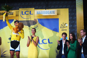Marcel Kittel of Germany and Giant Shimano celebrates winning stage one as Prince Harry, Catherine, Duchess of Cambridge, and William Duke of Cambridge look on during the 2014 Tour de France, a 190km stage between Leeds and Harrogate, on July 5, 2014 in Harrogate, England.