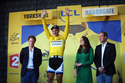 (l to r) Prince Harry, Marcel Kittel of Germany and Giant Shimano, Catherine, Duchess of Cambridge, and William Duke of Cambridge stand on the podium afterthe 2014 Tour de France, a 190km stage between Leeds and Harrogate, on July 5, 2014 in Harrogate, England.