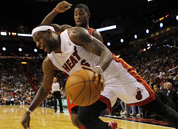 New Jersey Nets v Miami Heat [photograph,basketball,basketball moves,sports,basketball player,team sport,ball game,basketball court,player,sport venue,lebron james 6,terrence williams,user,user,note,terms,miami,miami heat,new jersey nets]
