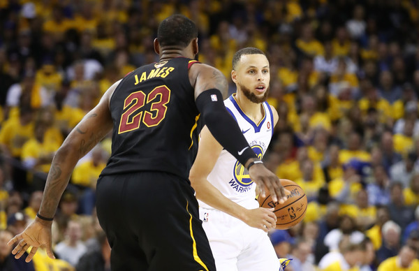 2018 NBA Finals - Game One [sports,team sport,ball game,player,sport venue,basketball player,fan,championship,tournament,basketball moves,game one,stephen curry,user,user,lebron james,note,ball,game,nba,finals]