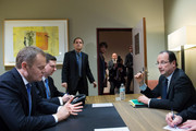 Polish Prime Minister Donald Tusk (L) and French President  Francois Hollande (R) sit during a meeting at the EU Headquarters on the first day of a two-day European Union leaders summit on February 7, 2013 in Brussels, Belgium, European Union leaders are set to duscuss the EU's budget.