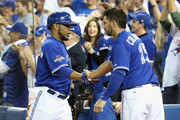Edwin Encarnacion #10 of the Toronto Blue Jays is congratulated by Chris Colabello #15 of the Toronto Blue Jays after scoring a run in the sixth inning against the Kansas City Royals during game five of the American League Championship Series at Rogers Centre on October 21, 2015 in Toronto, Canada.