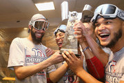 (L-R) David Price #24, Mookie Betts #50, and Eduardo Rodriguez #57 of the Boston Red Sox celebrate with the William Harridge Trophy in the clubhouse after defeating the Houston Astros 4-1 in Game Five of the American League Championship Series to advance to the 2018 World Series at Minute Maid Park on October 18, 2018 in Houston, Texas.
