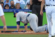 Jon Lester #34 of the Chicago Cubs falls down after attempting to bunt in the third inning against the Los Angeles Dodgers during game two of the National League Championship Series at Dodger Stadium on October 15, 2017 in Los Angeles, California.