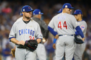 Jon Lester #34 of the Chicago Cubs  is taken out of the game against the Los Angeles Dodgers in the fifth inning during Game Two of the National League Championship Series at Dodger Stadium on October 15, 2017 in Los Angeles, California.
