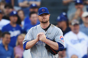 Jon Lester #34 of the Chicago Cubs reacts after giving up a double to Cody Bellinger #35 of the Los Angeles Dodgers (not pictured) in the third inning during game two of the National League Championship Series at Dodger Stadium on October 15, 2017 in Los Angeles, California.
