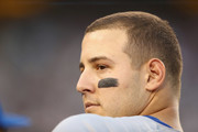 Anthony Rizzo #44 of the Chicago Cubs stands in the dugout during their game against the Los Angeles Dodgers during Game Two of the National League Championship Series at Dodger Stadium on October 15, 2017 in Los Angeles, California.