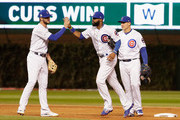 Kris Bryant #17, Jason Heyward #22, and Anthony Rizzo #44 of the Chicago Cubs celebrate after beating the Los Angeles Dodgers 3-2 in game four of the National League Championship Series at Wrigley Field on October 18, 2017 in Chicago, Illinois.
