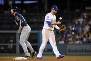 Ryan Braun #8 of the Milwaukee Brewers safely steals second base around the tag of Brian Dozier #6 of the Los Angeles Dodgers during the tenth inning in Game Four of the National League Championship Series at Dodger Stadium on October 16, 2018 in Los Angeles, California.