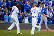Alex Gordon #4 of the Kansas City Royals celebrates with Alcides Escobar #2 of the Kansas City Royals after scoring a run in the seventh inning against the Toronto Blue Jays in game two of the American League Championship Series at Kauffman Stadium on October 17, 2015 in Kansas City, Missouri.