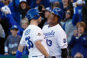 Eric Hosmer #35 of the Kansas City Royals celebrates with Salvador Perez #13 of the Kansas City Royals after scoring a run in the seventh inning against the Toronto Blue Jays in game two of the American League Championship Series at Kauffman Stadium on October 17, 2015 in Kansas City, Missouri.