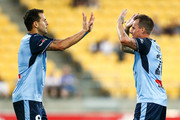 Bobo of Sydney FC celebrates with Luke Wilkshire after scoring a goal during the round 12 A-League match between the Wellington Phoenix and Sydney FC at Westpac Stadium on December 23, 2017 in Wellington, New Zealand.