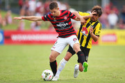 Shannon Cole of the Wanderers competes with Albert Riera of the Phoenix during the round 16 A-League match between the Western Sydney Wanderers and the Wellington Phoenix at Sportingbet Stadium on February 8, 2015 in Sydney, Australia.