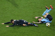 Christian Theoharous of the Victory challenges Luke Wilkshire of Sydney FC during the round 18 A-League match between Melbourne Victory and Sydney FC at AAMI Park on January 26, 2018 in Melbourne, Australia.