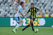 Liam Rose of the Mariners contests the ball against Luke Wilkshire of Sydney FC during the round 24 A-League match between the Central Coast Mariners and Sydney FC at Central Coast Stadium on March 24, 2018 in Gosford, Australia.